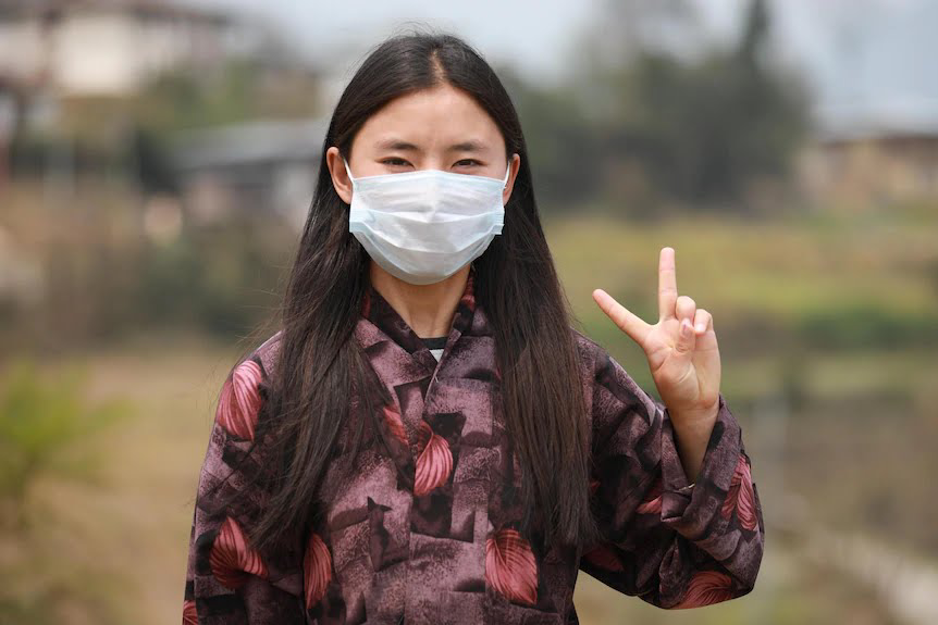 Khandu Lham, 19, received her first COVID-19 injection at a Bhutan vaccination centre. (UNICEF: S. Pelden)